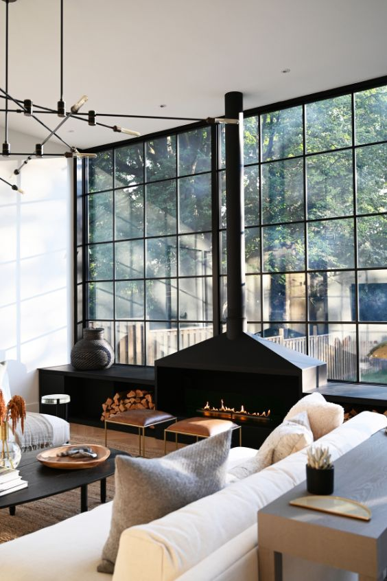 statement fireplace A Tired Bungalow Transformed Into a 2 Storey Family Dwelling by Ancerl Studio